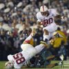 Photo - Stanford running back Ricky Seale jumps over Stanford fullback Ryan Hewitt and a Michigan State defender during the second half of the Rose Bowl NCAA college football game on Wednesday, Jan. 1, 2014, in Pasadena, Calif. Michigan State won 24-20. (AP Photo/Mark J. Terrill)