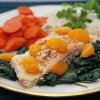 Citrus salmon with toasted almonds on a bed of sauteed spinach with carrots and brown rice, in Edmond, Okla., Friday, Febraury 20, 2009. For Becky Varner column. BY NATE BILLINGS, THE OKLAHOMAN