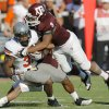Texas A&M\'s Charlie Thomas (9) and Trent Hunter (1) bring down Oklahoma State\'s Jeremy Smith in the second half of the Cowboys\' win on Saturday. Photo by Nate Billings, The Oklahoman