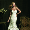 Allure Bridal fitted ruched taffeta gown in cream, accented with beading. Sold at Moliere Bridal, 800 Northwest Expressway. Photo provided. Jon Moe