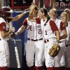 Alabama\'s Kayla Braud (1) celebrates with Jennifer Fenton (7), left, after Fenton scored in the fifth inning during Game 3 of the Women\'s College World Series softball championship between OU and Alabama at ASA Hall of Fame Stadium in Oklahoma City, Wednesday, June 6, 2012. Photo by Nate Billings, The Oklahoman