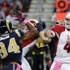 Arizona Cardinals quarterback Kevin Kolb, right, throws as St. Louis Rams defensive end Robert Quinn (94) defends during the first quarter of an NFL football game, Thursday, Oct. 4, 2012, in St. Louis. (AP Photo/Seth Perlman)