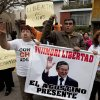 Photo -   Supporters of Peru's former and jailed President Alberto Fujimori shout slogans outside the Justice Ministry building with signs that read in Spanish