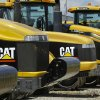 """Photo -   FILE - In this Wednesday, June 20, 2012, file photo, shows Caterpillar logos on earth moving tractors and equipment in Clinton, Ill. Caterpillar cut its profit and revenue guidance on Monday, Oct. 22, 2012, saying the world's economic conditions """"are weaker than we had previously expected."""" Caterpillar Inc. is the world's largest construction and mining equipment maker, so its results are watched closely as a sign of where the broader economy is headed. (AP Photo/Seth Perlman)"""