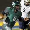 Edmond Santa Fe\'s Justice Hansen (11) keeps the ball during a high school football game between Edmond Santa Fe and Southmoore at Wantland Stadium in Edmond, Okla., Thursday, Sept. 20, 2012. Photo by Nate Billings, The Oklahoman