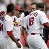 Photo - St. Louis Cardinals' Yadier Molina, second from left, celebrates with teammates Carlos Martinez (44), Oscar Taveras (18) and Jhonny Peralta after scoring a baseball game-winning run on a single by Peter Bourjos during the ninth inning against the Pittsburgh Pirates, Wednesday, Sept. 3, 2014, in St. Louis. The Cardinals won 1-0. (AP Photo/Jeff Roberson)