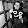 FILE - In this Feb. 3, 1959 file photo, Dick Clark selects a record in his station library in Philadelphia. Clark, the television host who helped bring rock `n\' roll into the mainstream on