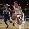 Oklahoma City\'s Thabo Sefolosha (2) drives against Memphis\' Mike Conley Jr. (11) during the NBA basketball game between the Oklahoma City Thunder and the Memphis Grizzlies at Chesapeake Energy Arena on Wednesday, Nov. 14, 2012, in Oklahoma City, Okla. Photo by Chris Landsberger, The Oklahoman