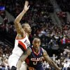 Atlanta Hawks guard Jeff Teague, right, works the ball against Portland Trail Blazers guard Damian Lillard during the first half of their NBA basketball game in Portland, Ore., Monday, Nov. 12, 2012. (AP Photo/Don Ryan)