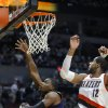 Charlotte Bobcats\' Jeff Adrien (4) shoots against Portland Trail Blazers\' LaMarcus Aldridge (12) during the first half of an NBA basketball game in Portland, Ore., Monday, March 4, 2013. (AP Photo/Greg Wahl-Stephens)