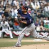 Minnesota Twins starting pitcher Ricky Nolasco delivers during the first inning of an Opening Day baseball game against the Chicago White Sox Monday, March 31, 2014, in Chicago. (AP Photo/Charles Rex Arbogast)