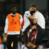 Photo - Liverpool's Steven Gerrard, centre, helps teammate Luis Suarez, following the end of the English Premier League soccer match between Crystal Palace and Liverpool at Selhurst Park stadium in London, Monday, May 5, 2014. The game ended in a 3-3 draw. (AP Photo/Alastair Grant)