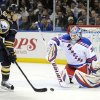 Buffalo Sabres center Tyler Ennis (63) deflects the puck at New York Rangers goaltender Henrik Lundqvist (30), of Sweden, during the first period of an NHL hockey game in Buffalo, N.Y., Friday, April 19, 2013. (AP Photo/Gary Wiepert)