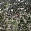 This photo released by the Philippine Army\'s 10th Infantry Division shows an aerial view of houses damaged by flash floods caused by Typhoon Bopha in Compostela Valley province, in the southern Philippines on Thursday Dec. 6, 2012. The powerful typhoon that washed away emergency shelters, a military camp and possibly entire families in the southern Philippines has killed hundreds of people with nearly 400 missing, authorities said Thursday. (AP Photo/Philippine Army 10th Infantry Division) NO SALES