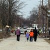 Locals survey the damage along Versailles Street in Holton, Ind. on Sunday, March 4, 2012. A string of violent storms scratched away small towns in Indiana and cut off rural communities in Kentucky as an early-season tornado outbreak struck on Friday, killing at least 37 people. (AP Photo/Ernest Coleman) ORG XMIT: INEC104