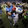 Detroit Lions wide receiver Calvin Johnson hugs Atlanta Falcons quarterback Matt Ryan (2) after an NFL football game at Ford Field in Detroit, Saturday, Dec. 22, 2012. Johnson broke the single-season record for receiving yards. (AP Photo/Duane Burleson)