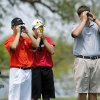 From left, Nick Pierce of Sallisaw, Cody Shore of Poteau and Quade Cummins of Weatherford look through rangefinder devices before hitting off the 18th tee box during Class 4A boy\'s state golf tournament on Tuesday, May 7, 2013, at Hefner Golf Course in Oklahoma City. Photo by Jim Beckel, The Oklahoman.