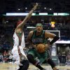Boston Celtics\' Paul Pierce, right, tries to drive past Milwaukee Bucks\' Marquis Daniels during the first half of an NBA basketball game on Saturday, Dec. 1, 2012, in Milwaukee. (AP Photo/Morry Gash)