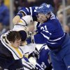 Photo - Buffalo Sabres' Brian Flynn fights Toronto Maple Leafs' Phil Kessel, left, during the third period of an NHL hockey preseason game in Toronto, Sunday Sept. 22, 2013. (AP Photo/The Canadian Press, Frank Gunn)