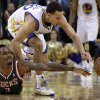 Milwaukee Bucks\' Brandon Jennings (3) and Golden State Warriors\' Stephen Curry chase a loose ball during the second half of an NBA basketball game Saturday, March 9, 2013, in Oakland, Calif. (AP Photo/Ben Margot)