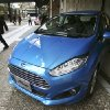 Photo - A man looks at a Ford Fiesta compact car in Tokyo Thursday, Jan. 9, 2014. Ford's Fiesta compact is back in Japan despite failing a decade ago in a market dominated by Toyota and other powerful local brands that specialize in small cars. (AP Photo/Koji Sasahara)