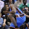 Oklahoma City Thunder forward Serge Ibaka (9) from the Republic of Congo holds his head after a collision with a Denver Nuggets player during the first half of game 3 of a first-round NBA basketball playoff series Saturday, April 23, 2011, in Denver. (AP Photo/Jack Dempsey)