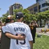 Two mourner console each other at the Tony Gwynn