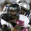 Edmond Santa Fe\'s Patrick Hinton is brought down by Edmond North\'s Christian Peterson during a high school football game at Wantland Stadium in Edmond, Okla., Friday, Oct. 29, 2010. Photo by Bryan Terry, The Oklahoman
