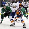New York Islanders right wing Kyle Okposo (21) controls the puck on his way to the net for a shot attempt as Dallas Stars defenseman Sergei Gonchar (55), of Russia, defends in the second period of an NHL hockey game, Sunday, Jan. 12, 2014, in Dallas. (AP Photo/Tony Gutierrez)