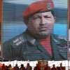 An image of Venezuela\'s President Hugo Chavez is shown on a large screen as Bolivia\'s President Evo Morales, bottom left, speaks to the crowd attending Chavez\'s symbolic inauguration outside Miraflores presidential palace in Caracas, Venezuela, Thursday, Jan. 10, 2013. The government organized the unusual show of support for the cancer-stricken leader on the streets outside Miraflores Palace on what was supposed to be his inauguration day. The Venezuelan leader, normally at the center of national attention, is so ill following a fourth cancer surgery in Cuba that he has made no broadcast statement in more than a month, and has not appeared in a single photo. Officials have not specified what sort of cancer he suffers or which hospital is treating him. (AP Photo/Fernando Llano)