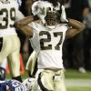 New Orleans Saints\' Malcolm Jenkins (27) celebrates after stopping Indianapolis Colts\' Chad Simpson (35) on a kick return during the second half of the NFL Super Bowl XLIV football game in Miami, Sunday, Feb. 7, 2010. (AP Photo/Chuck Burton) ORG XMIT: SB360