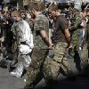 Photo - Pro-Russian rebels escort prisoners of war from the Ukrainian army in a central square in Donetsk, eastern Ukraine, Sunday, Aug. 24, 2014. Ukraine has retaken control of much of its eastern territory bordering Russia in the last few weeks, but fierce fighting for the rebel-held cities of Donetsk and Luhansk persists. (AP Photo/Sergei Grits)