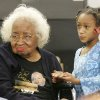 Civil rights pioneer Clara Luper and 9yr-old Alexia Grant watch the Inauguration of President Barack Obama. Luper was watching TV at the Freedom Center at NE 26th and Martin Luther King Blvd. in Oklahoma City , Okla. January 20, 2009. BY STEVE GOOCH, THE OKLAHOMAN.