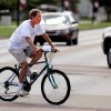 A bicyclist crosses Boyd Street at Asp in Norman, Monday afternoon, July 19, 2010. Photo by Jim Beckel, The Oklahoman