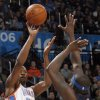 Oklahoma City\'s Kevin Durant (35) shoots over Memphis\' Zach Randolph (50) during the NBA basketball game between the Oklahoma City Thunder and the Memphis Grizzlies, Saturday, Jan. 8, 2011, at the Oklahoma City Arena. Photo by Sarah Phipps, The Oklahoman