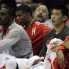 Houston Rockets\' Jeremy Lin, right, sits on the bench with ice on his knee in the first quarter of an NBA basketball game against the Portland Trail Blazers, Saturday, Nov. 3, 2012, in Houston. Lin re-entered the game in the second quarter. (AP Photo/Pat Sullivan)