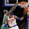 Photo - Boston Celtics forward Kevin Garnett (5) dunks against New York Knicks forward Carmelo Anthony (7) in the first half of their NBA basketball game at Madison Square Garden in New York, Monday, Jan. 7, 2013. (AP Photo/Kathy Willens)