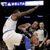 Photo - San Antonio Spurs guard Manu Ginobili (20) tries to stay in bounds as he passes around New York Knicks forward Amare Stoudemire (1) in the first half of their NBA basketball game at Madison Square Garden in New York, Thursday, Jan. 3, 2013. (AP Photo/Kathy Willens)
