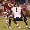 Oklahoma\'s Dominique Whaley (8) tries to get past Missouri\'s Kip Edwards (1) during the college football game between the University of Oklahoma Sooners (OU) and the University of Missouri Tigers (MU) at the Gaylord Family-Memorial Stadium on Saturday, Sept. 24, 2011, in Norman, Okla. Photo by Chris Landsberger, The Oklahoman
