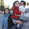 Photo - San Diego mayoral candidate David Alvarez, carries his daughter, Izel, as he and his wife, Xochitl, arrive at a polling location in the Logan Heights neighborhood where Alvarez grew up and still lives Tuesday, Feb. 11, 2014 in San Diego. (AP Photo/Lenny Ignelzi)