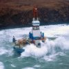 This image provided by the U.S. Coast Guard shows the Royal Dutch Shell drilling rig Kulluk aground off a small island near Kodiak Island Tuesday Jan. 1, 2013. A Coast Guard C-130 plane and a helicopter were used to fly over the grounded vessel on Tuesday morning. The severe weather did not permit putting the marine experts on board the drilling rig, which is near shore and being pounded by stormy seas. (AP Photo/U.S. Coast Guard)