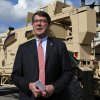 FILE - This Nov. 2, 2009, file photo shows Deputy Defense Secretary Ashton Carter standing in front of a MRAP all terrain vehicle (M-ATV) at the Pentagon in Washington. The Afghan war effort eventually would be harmed by across-the-board budget cuts, even as the Obama administration intends to shield the military\'s combat mission from the reductions, Carter said Friday, Jan. 25, 2012.