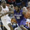 Photo - Kansas State's Omari Lawrence (12) moves the ball past Texas defender Sheldon McClellan, left, during the first half on an NCAA college basketball game, Saturday, Feb. 23, 2013, in Austin, Texas. (AP Photo/Eric Gay)