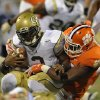Photo - Gergia Tech quarterback Vad Lee, left, is sacked by Clemson's Corey Crawford during the first half of an NCAA college football game Thursday, Nov.14, 2013, in Clemson, S.C. (AP Photo/ Richard Shiro)