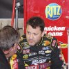 Driver Tony Stewart talks with a crew member in the garage after practice for Sunday\'s NASCAR Sprint Cup series auto race at Martinsville Speedway in Martinsville, Va., Saturday, April 6, 2013. (AP Photo/Steve Sheppard)