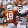 Oklahoma\'s Landry Jones (12) is rushed by Texas\' Emmanuel Acho (18) on a pass attempt during the Red River Rivalry college football game between the University of Oklahoma Sooners (OU) and the University of Texas Longhorns (UT) at the Cotton Bowl in Dallas, Saturday, Oct. 8, 2011. Photo by Chris Landsberger, The Oklahoman