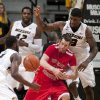 Southeast Missouri State\'s Nick Niemczyk, center, loses control of the ball between Missouri\'s Tony Criswell, right, Keion Bell, left front, and Alex Oriakhi, back, during the second half of an NCAA college basketball game Tuesday, Dec. 4, 2012, in Columbia, Mo. Missouri won 81-65. (AP Photo/L.G. Patterson)