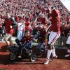 Titus and Tobias Tate lead the team onto the field before the college football game between the University of Oklahoma Sooners (OU) and the Iowa State University Cyclones (ISU) at Gaylord Family-Oklahoma Memorial Stadium in Norman, Okla. on Saturday, Nov. 16, 2013. Photo by Steve Sisney, The Oklahoman