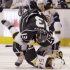 Photo - Los Angeles Kings left winger Kyle Clifford (13) and Boston Bruins defenseman Adam McQuaid (54) fight in the second period of an NHL hockey game in Los Angeles Thursday, Jan. 9, 2014. (AP Photo/Reed Saxon)