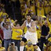 Golden State Warriors\' Andrew Bogut celebrates after scoring against the Denver Nuggets during the second half of Game 6 in a first-round NBA basketball playoff series in Oakland, Calif., Thursday, May 2, 2013. Golden State won 92-88. (AP Photo/Marcio Jose Sanchez)